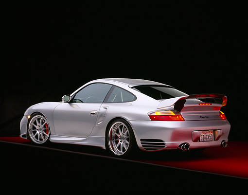 POR 04 RK0552 03 © Kimball Stock 2004 Porsche X50 Turbo Silver 3/4 Rear View On Red Floor Gray Line Studio