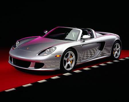 POR 04 RK0570 05 © Kimball Stock 2004 Porsche Carrera GT Silver 3/4 Front View On Red Floor Checkered Line Studio