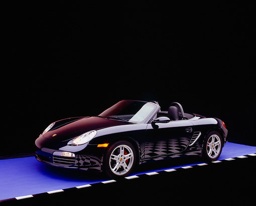 POR 04 RK0596 01 © Kimball Stock 2005 Porsche Boxster S Convertible Dark Blue 3/4 Side View On Purple Floor Checkered Line Studio