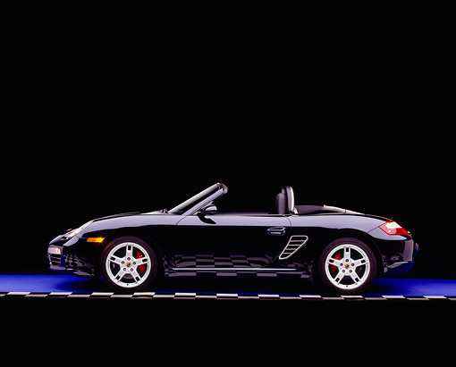 POR 04 RK0597 05 © Kimball Stock 2005 Porsche Boxster S Convertible Dark Blue Profile View On Purple Floor Checkered Line Studio