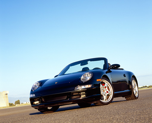 POR 04 RK0605 02 © Kimball Stock 2005 Porsche 911 S Carrera Convertible Black Slanted Low 3/4 Front View On Pavement