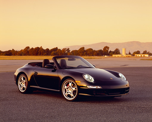 POR 04 RK0608 02 © Kimball Stock 2005 Porsche 911 S Carrera Convertible Black 3/4 Side View On Pavement Filtered