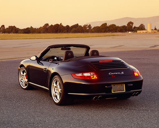 POR 04 RK0613 02 © Kimball Stock 2005 Porsche 911 S Coupe Convertible Black 3/4 Rear View On Pavement Filtered