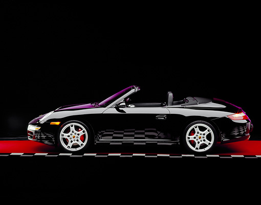 POR 04 RK0617 04 © Kimball Stock 2005 Porsche 911 S Carrera Convertible Black Profile View On Red Floor Checkered Line Studio