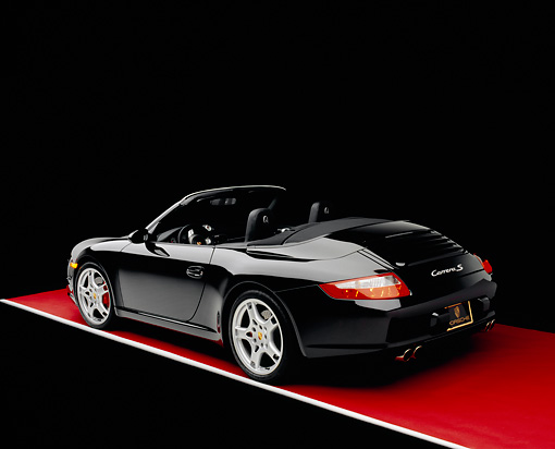 POR 04 RK0618 05 © Kimball Stock 2005 Porsche 911 Carrera Convertible Black 3/4 Rear View On Red Floor Gray Line Studio