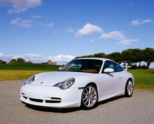POR 04 RK0626 04 © Kimball Stock 2005 Porsche 911 GT3 Coupe White 3/4 Front View On Pavement By Grass And Trees