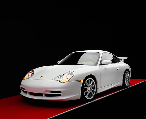 POR 04 RK0632 02 © Kimball Stock 2005 Porsche 911 GT3 Coupe White 3/4 Front View On Red Floor Gray Line Studio
