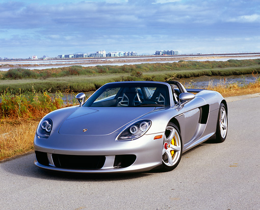 POR 04 RK0639 02 © Kimball Stock 2005 Porsche Carrera GT Silver 3/4 Front View On Pavement By Marsh