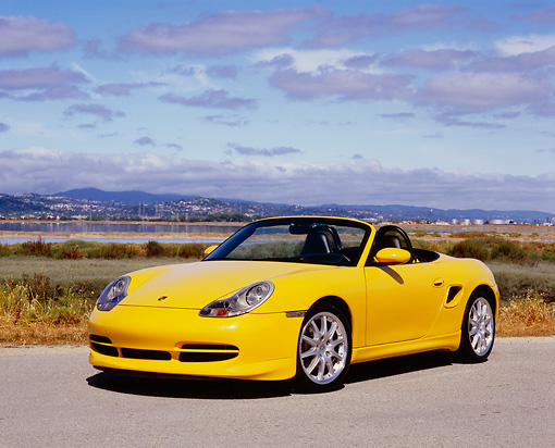 POR 04 RK0641 01 © Kimball Stock 2000 Porsche Boxster Yellow Front 3/4 View On Pavement By Marsh