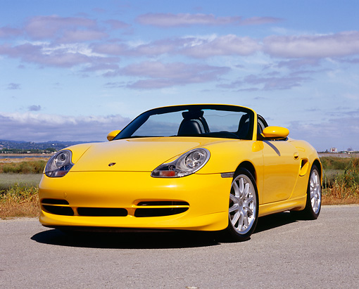 POR 04 RK0643 02 © Kimball Stock 2000 Porsche Boxster Yellow Low 3/4 Front View On Pavement By Marsh