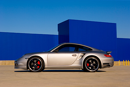 POR 04 RK0666 01 © Kimball Stock 2007 Porsche 911 Turbo Silver Profile View On Pavement By Building