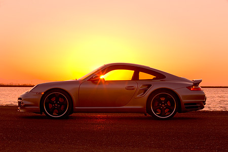 POR 04 RK0672 01 © Kimball Stock 2007 Porsche 911 Turbo Silver Profile View By Water At Sunset