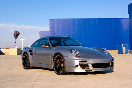 POR 04 RK0688 01 © Kimball Stock 2007 Porsche 911 Turbo Silver 3/4 Front View On Pavement By Building