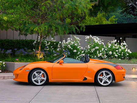 POR 04 RK0692 01 © Kimball Stock 2007 Porsche RUF Spyder Orange Profile View On Pavement By Trees And Flowers