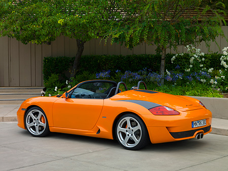 POR 04 RK0693 01 © Kimball Stock 2007 Porsche RUF Spyder Orange 3/4 Rear View On Pavement By Trees And Flowers