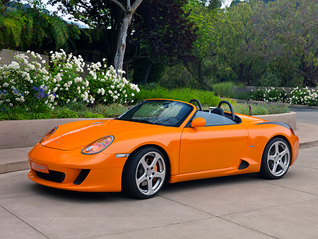 POR 04 RK0694 01 © Kimball Stock 2007 Porsche RUF Spyder Orange 3/4 Front View On Pavement By Trees And Flowers