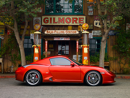 POR 04 RK0699 02 © Kimball Stock 2007 Porsche RUF RK Coupe Red Profile View On Pavement Gas Station