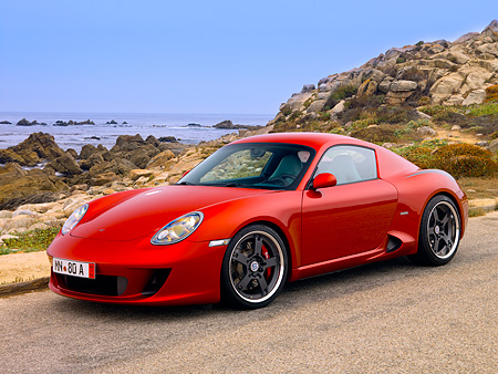 POR 04 RK0703 01 © Kimball Stock 2007 Porsche RUF RK Coupe Red 3/4 Side View On Pavement By Ocean And Rocks