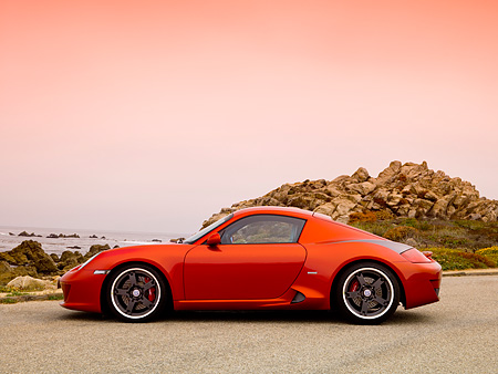 POR 04 RK0704 01 © Kimball Stock 2007 Porsche RUF RK Coupe Red Profile View On Pavement By Ocean And Rocks