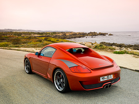 POR 04 RK0705 01 © Kimball Stock 2007 Porsche RUF RK Coupe Red 3/4 Rear View On Pavement By Ocean And Rocks