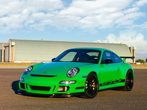 POR 04 RK0751 01 © Kimball Stock 2007 Porsche 911 GT3 RS Green 3/4 Front View On Pavement By Hangar Blue Sky