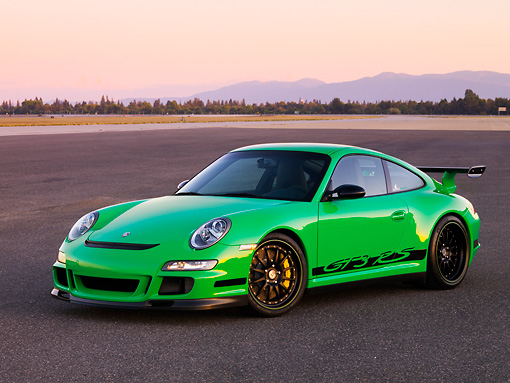 POR 04 RK0755 01 © Kimball Stock 2007 Porsche 911 GT3 RS Green 3/4 Front View On Pavement By Trees Mountain Sky