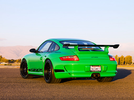 POR 04 RK0758 01 © Kimball Stock 2007 Porsche 911 GT3 RS Green 3/4 Rear View On Pavement By Trees Mountain Sky