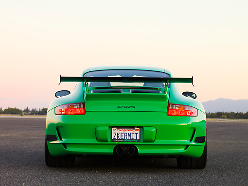 POR 04 RK0759 01 © Kimball Stock 2007 Porsche 911 GT3 RS Green Rear View On Pavement By Trees Mountain Sky