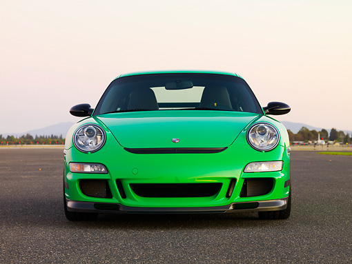 POR 04 RK0763 01 © Kimball Stock 2007 Porsche 911 GT3 RS Green Front View On Pavement By Trees Mountain Sky