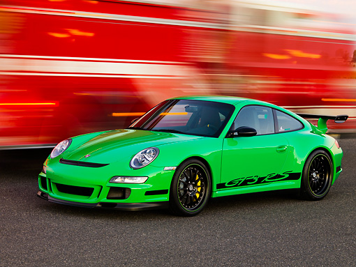 POR 04 RK0766 01 © Kimball Stock 2007 Porsche 911 GT3 RS Green 3/4 Front View On Pavement By Passing Fire Truck