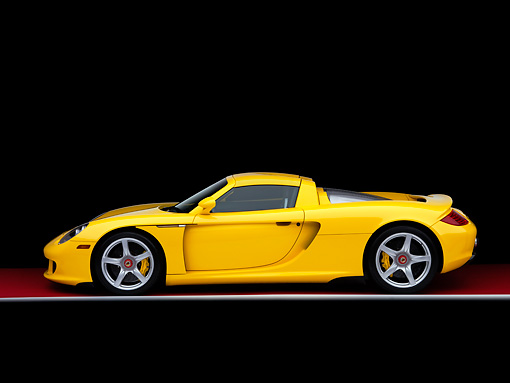 POR 04 RK0770 01 © Kimball Stock 2005 Porsche Carrera GT Fayence Yellow Profile View Studio