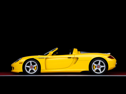 POR 04 RK0772 01 © Kimball Stock 2005 Porsche Carrera GT Fayence Yellow Profile View Studio
