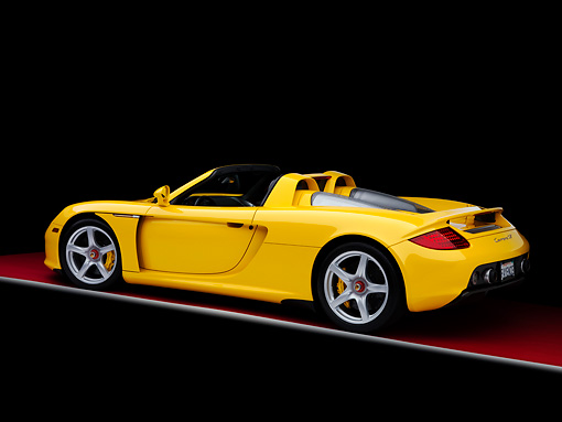 POR 04 RK0773 01 © Kimball Stock 2005 Porsche Carrera GT Fayence Yellow 3/4 Rear View Studio