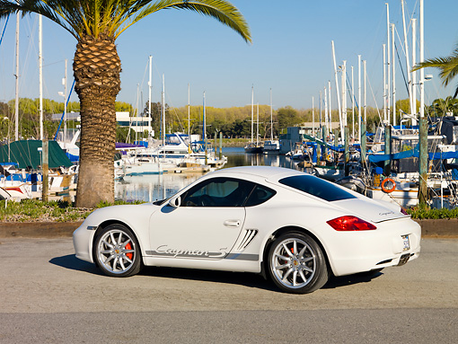 POR 04 RK0814 01 © Kimball Stock 2008 Porsche Cayman S Coupe White 3/4 Rear View On Pavement By Marina