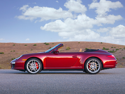 POR 04 RK0816 01 © Kimball Stock 2009 Porsche 911 Carrera 4S Convertible Red Profile View On Pavement By Hills
