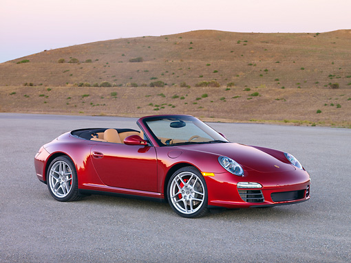 POR 04 RK0819 01 © Kimball Stock 2009 Porsche 911 Carrera 4S Convertible Red 3/4 Front View On Pavement By Hills