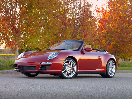POR 04 RK0822 01 © Kimball Stock 2009 Porsche 911 Carrera 4S Convertible Red 3/4 Front View On Pavement By Trees