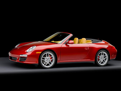 POR 04 RK0827 01 © Kimball Stock 2009 Porsche 911 Carrera 4S Convertible Red 3/4 Front View Studio