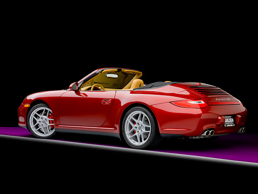 POR 04 RK0829 01 © Kimball Stock 2009 Porsche 911 Carrera 4S Convertible Red 3/4 Rear View Studio