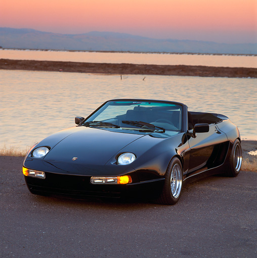 POR 05 RK0018 05 © Kimball Stock 1990 Porsche 928 S Koenig Cabriolet 3/4 Front View On Pavement By Water