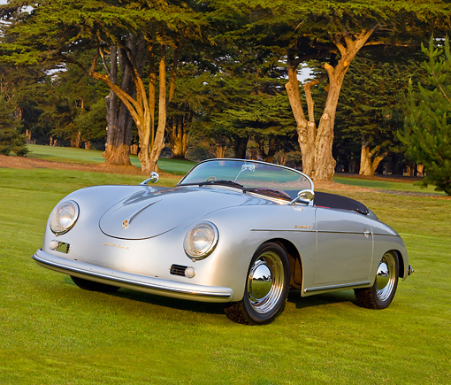 POR 06 BK0003 01 © Kimball Stock 1957 Porsche 356 Speedster Convertible Silver 3/4 Front View On Grass By Trees