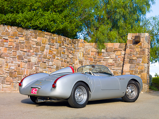 POR 06 RK0028 01 © Kimball Stock 1955 Porsche 550 Spyder Silver 3/4 Rear View On Pavement By Stone Wall