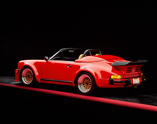 POR 07 RK0003 02 © Kimball Stock 1989 Porsche 911 Speedster Convertible Anniversary Edition Red 3/4 Rear View On Red Line Studio