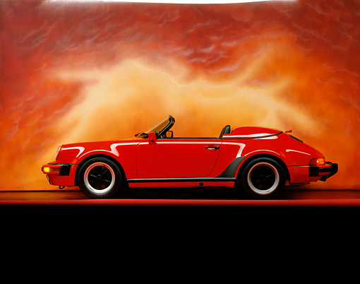 POR 07 RK0045 05 © Kimball Stock 1989 Porsche 911 Speedster Convertible Red Profile View On Red Line Studio