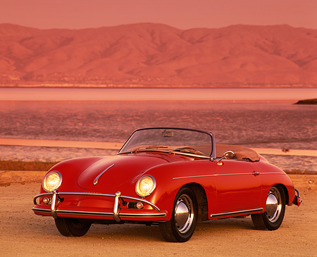 POR 07 RK0057 07 © Kimball Stock 1959 Red Porsche Speedster 3/4 Front View By Water And Mountains Filtered