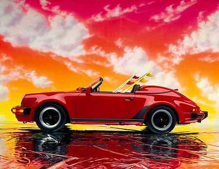 POR 07 RK0068 01 © Kimball Stock 1989 Porsche 911 Speedster Convertible Red Side View With Surfboard On Mylar Floor Red Clouds