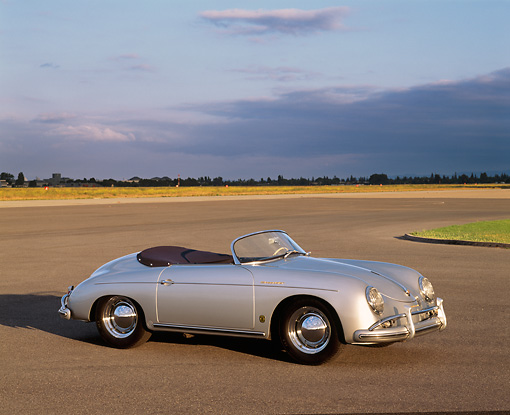 POR 07 RK0071 03 © Kimball Stock 1958 Porsche Speedster Silver 3/4 Side View On Pavement