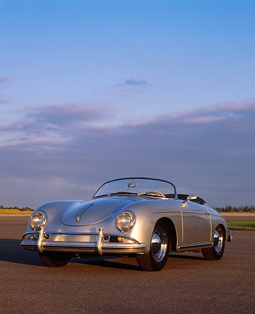 POR 07 RK0076 02 © Kimball Stock 1958 Porsche Speedster Silver  3/4 Front View On Pavement With Sky And Clouds