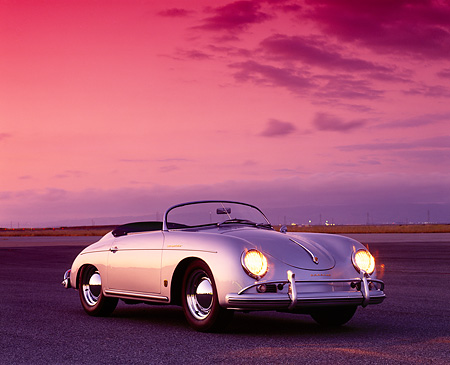 POR 07 RK0081 07 © Kimball Stock 1958 Porsche Speedster Silver Low 3/4 Front View On Pavement Filtered