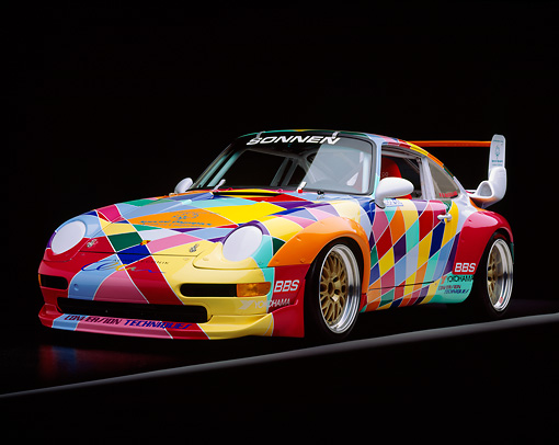 POR 27 RK0001 02 © Kimball Stock 1997 Porsche GT2 Multicolored Racing Car 3/4 Front View On Gray Line Studio